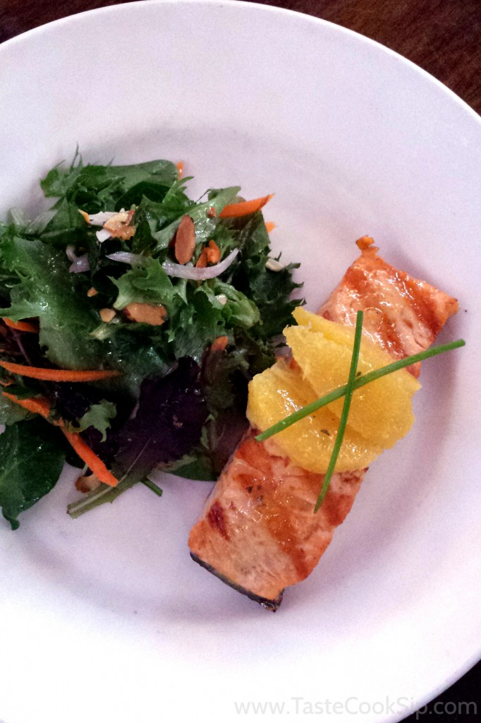Citrus Salmon - Grilled filet of Atlantic with mixed greens, carrots, orange segments & toasted almonds tossed in a citrus herb vinaigrette.