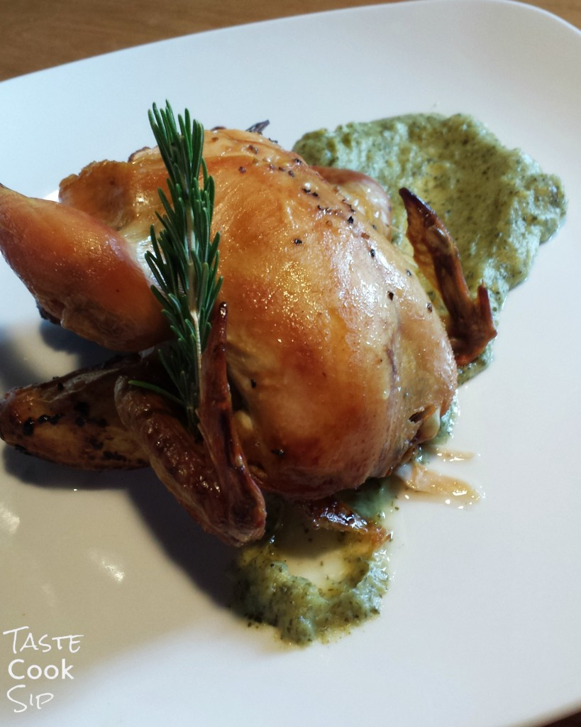 Cornish Game Hen stuffed with herbs and roasted lemons, with roasted fingerling potatoes over a spinach & parsnip puree.